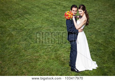 Bride And Groom On Green Grass Background