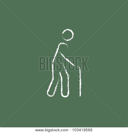 Man with cane hand drawn in chalk on a blackboard vector white icon isolated on a green background.