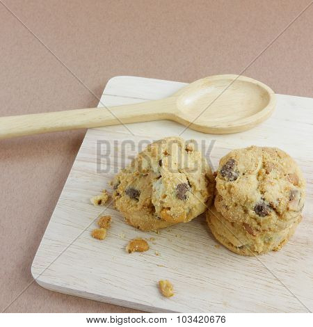 Homemade almond cookies on chopping board. (2) poster