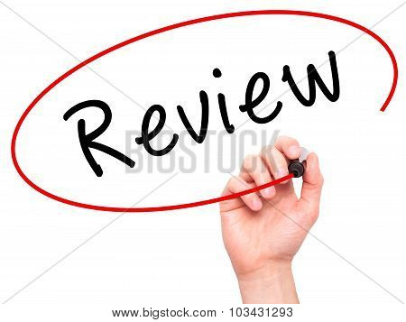 Man Hand writing Review with marker on transparent wipe board.