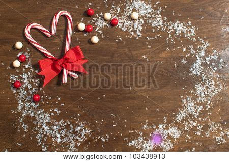 Candy cane as a Christmas decoration, free space for text