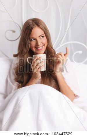 Beautiful Happy Woman Relaxing In The Bed