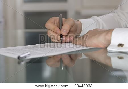 Businessman hands working on paper document