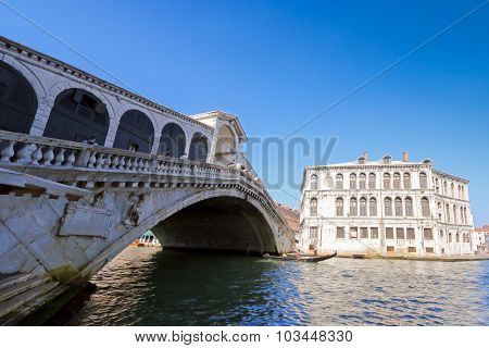 VENICE, ITALY - SEPTEMBER 2014 : The Rialto Bridge (Ponte di Rialto) over the Grand Canal in Venice, Italy on September 15, 2014. Rialto Bridge is the oldest bridge across the canal.