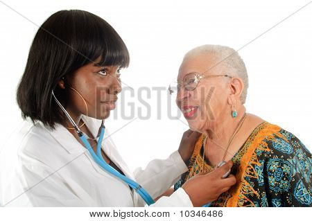 Young Nurse Checking Patient