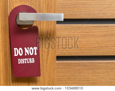 Do Not Disturb door hanger hanging on hotel room door handle