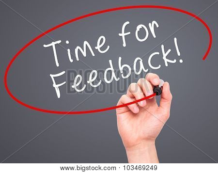 Man Hand writing Time for Feedback with black marker on visual screen
