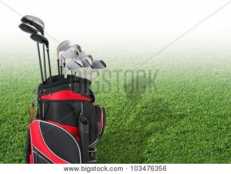 Golf Clubs In Front Of Faded Tee Box Grass