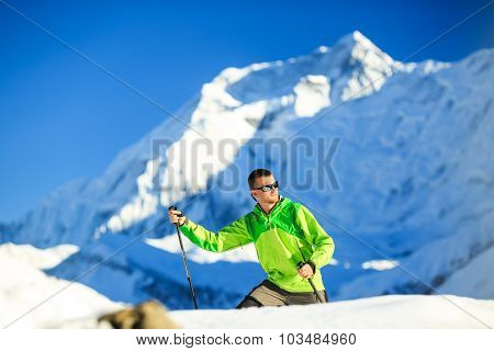Man hiker trekking in high Himalaya Mountains in Nepal. Happy hiking climbing in white winter or aut