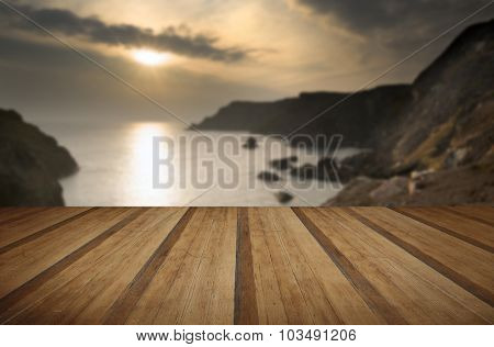 Spring sunset at high tide at Kynance Cove with wooden planks floor