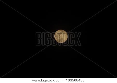 African Harvest Moon In Black Sky