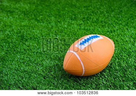 Toy Football On Artificial Grass Background
