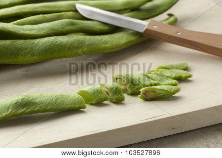 Fresh cut runner beans on a cutting board
