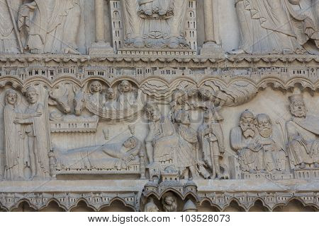 Paris - West facade of Notre Dame Cathedral. The Saint Anne portal and tympanum