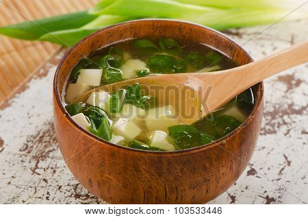 Miso Soup On A White Wooden Table.