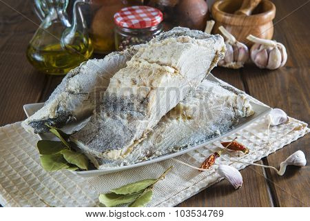 Salted Cod Cut On The Table Of The Kitchen