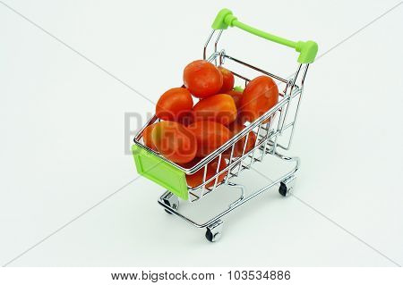 Shopping cart with Cherry Tomatoes isolated on white background