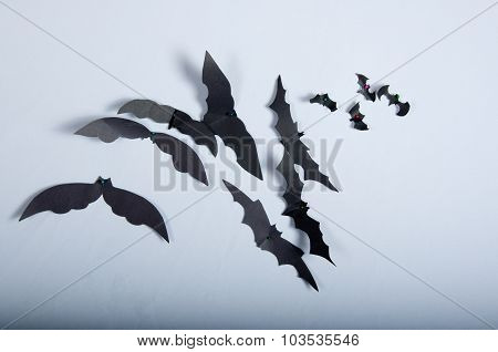 Paper Bats On The White Cloth