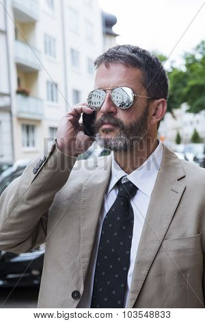 Man With glasses Talking On The Phone