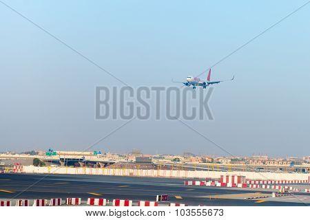 Passenger Liner From Spicejet, On Final Approach For Landing At Dubai International Airport.