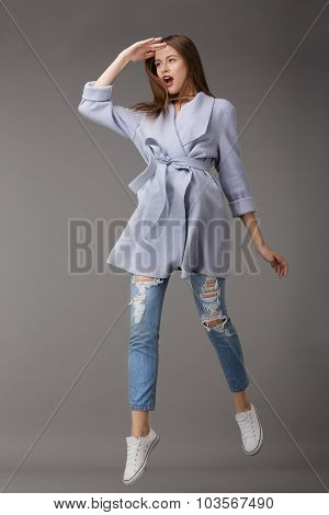 Emotional Young Woman In Outer Garments