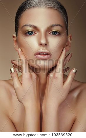 Vogue Style. Young Woman With Bronzed Skin