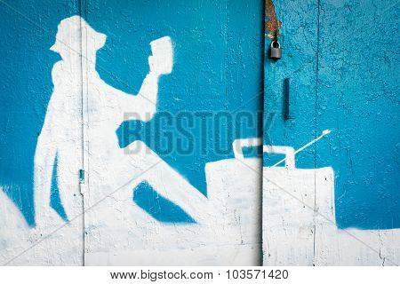 Moscow, Russia - September 27, 2015: A Blue And White Silhoette Of A Painted Person On The Garage Wa