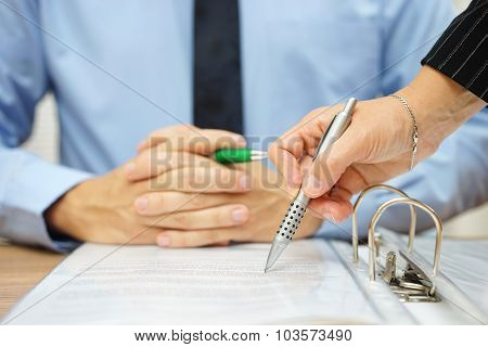 Business Man And Woman Checking Proposal Of Contract