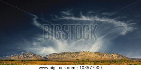Beautiful scene of the  sierra nevada Mountainrange in california with farmland in the foreground