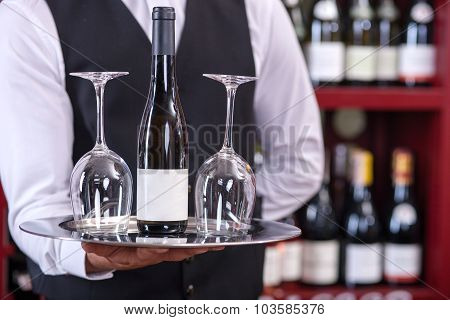 Professional male sommelier is serving alcohol drink