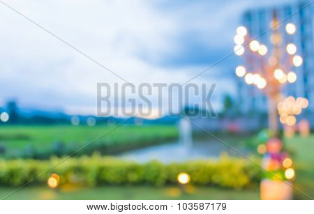 Image Of Blur Green Field , Pond And Building With Bokeh On Evening Time