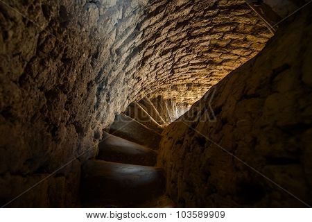 Weathered spiral stairway. Interior of old medieval asian minaret / poster