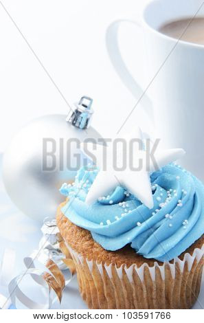 Christmas treat mug of hot chocolate, frosty icy blue theme cupcake with silver xmas bauble decorations  poster