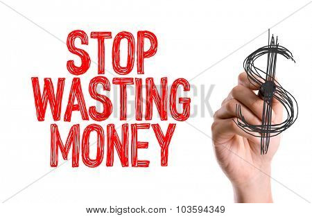 Hand with marker writing: Stop Wasting Money