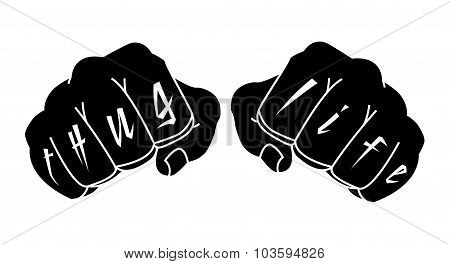 Black color arms with Thug Life tattoo on fingers