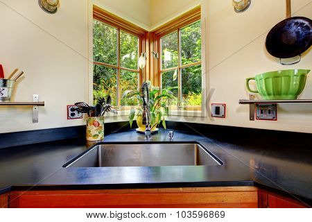 Nice Sink With Black Counter Top.