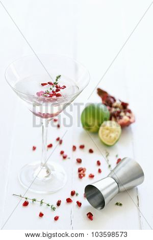 Martini cocktail mocktail with lime and  pomegranate pips