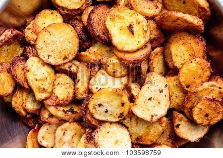 Closeup macro picture of fried colocasia vegetable kept in a stainless steel container