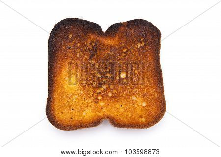 A piece of burnt toast on white background.