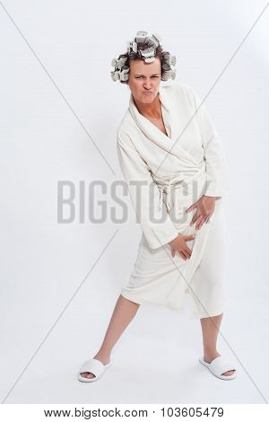 Woman In Robe And Slippers Posing With Pursed Lips
