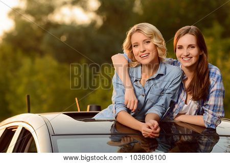 Cheerful girls sitting in the car