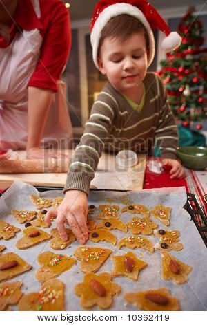 Small Child Helping With Christmas Cake