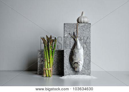 Dorada With Asparagus And Garlic And Sea Salt Presented On Stone