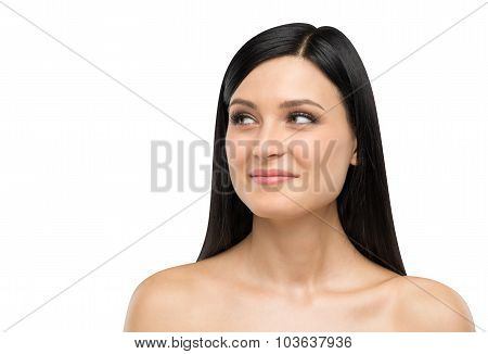 A Portrait Of A Smiling Brunette Lady Who Is Looking At Something On The Right Side. Isolated On Whi