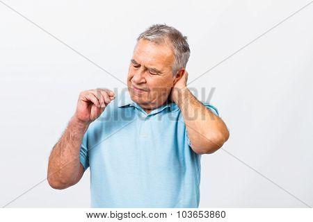 Senior man taking pills for pain in neck