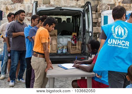 KOS, GREECE - SEP 27, 2015: War refugees are registered by employees of the UNHCR. Kos island is located just 4 kilometers from the Turkish coast, and refugees come from Turkey on inflatable boats.