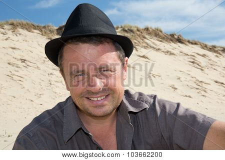 Handsome Man With A Hat Looking At The Camera