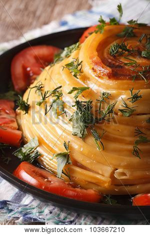French Timbale Of Pasta Close-up On A Plate. Vertical