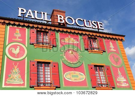 Lyon, France - September 25, 2015: Facade of the restaurant Paul Bocuse. Paul Bocuse, 3 stars at the Michelin guide, is a french chef based in Lyon who is famous for the high quality of his restaurant.