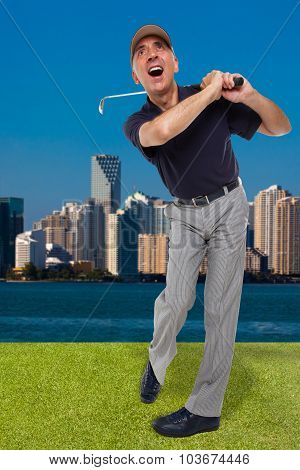Mature golfer swinging his golf club out on the course